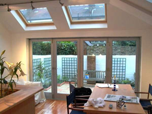 Beau Rear Kitchen Extension With A Pitched Roof With Velux Windows Above The  Folding Door System.